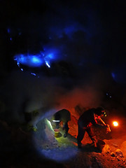 Sulphur miners in the Ijen crater, Indonesia (jonhuskisson) Tags: travel blue people indonesia fire person volcano java asia seasia southeastasia mining flame human backpacking crater sulphur sulfur extraction bluefire ijencrater ijen vision:night=0954