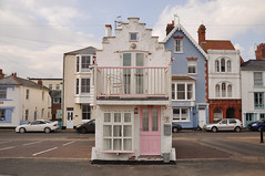 DSC_1203 [ps] - Left by the tide (Anyhoo) Tags: street uk pink blue houses england urban white house window wall facade standing buildings island town suffolk seaside alone pastel balcony small cottage backstreet erosion single lane neat behind carpark kingstreet aldeburgh isolated faade survivor twee pastelcolours anyhoo steppedgable cragpath photobyanyhoo