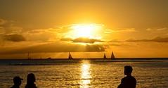 Waikiki Sunset (Jason Fairbairn Photography) Tags: sunset cloud sun water sunshine silhouette clouds boats hawaii boat sailing waikiki sail rays waikikibeach sunray waikikisunset