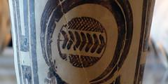 """Bushel with ibex motifs, detail of """"baseball stiching"""""""