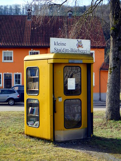 Phone booth converted into library