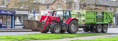 Rural Town Mix (M C Smith) Tags: farming tractor trailer shops road pentax kp signs grass pavement green railings bin