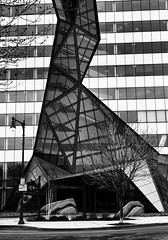 Fractured facade (trochford) Tags: educationfirst officebuilding building facade glass entry abstract irregular angular design architecture black white contrast cambridge cambridgema cambridgemassachusetts ma massachusetts newengland usa bw bnw blackandwhite blackwhite noiretblanc blancoynegro mono monochrome canon ef24105mmf4lisusm outdoor exterior