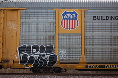 Eerie (Chicago City Limits) Tags: freight train graff graffiti benching rails railroad benched freights fr8s art artwork motion steel trains tracks auto racks rack autorack autoracks holy roller rollers eerie