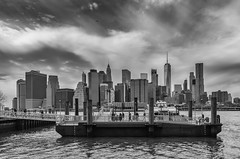 Moody Manhattan (SarahO44) Tags: 6d america apple big canon new nyc state united usa york manhattan lower freedom tower one world trade centre skyline black white monochrome moody sky outdoors urban landscape east river water taxi pontoon clouds
