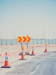 Dubai (miemo) Tags: dubai middleeast uae unitedarabemirates arrows bend construction curve direction em5mkii minimalism olympus olympus1240mmf28 omd road sand trafficsign travel tr ae