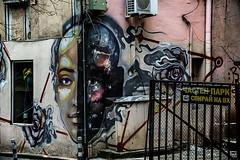 Whose side are you on? (Melissa Maples) Tags: софия sofia българия bulgaria europe nikon d3300 ニコン 尼康 nikkor afs 18200mm f3556g 18200mmf3556g vr sofiagraffititour winter graffiti streetart art corner face nasimo mural bulgarian text sign