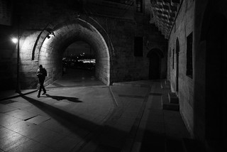 about to cross a line / a corner, a tunnel, a shadow