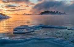 Fire and Ice (rugbike) Tags: ice fire steam freezing snow frost sunset winter cold sea baltic
