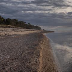 Looking South (peter_hasselbom) Tags: djauvik djupvik gotland balticsea baltic landscape sea sky clouds coast coastline sunset settingsun beach sand calmsea calm 3exposurehdr hdr fujifilm
