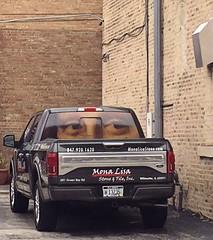 Mona Lisa's Eyes (Renee Rendler-Kaplan) Tags: monalisa truck business alleyway wilmetteillinois iphone iphoneography frommycarwindow reneerendlerkaplan april 2017 consumerist chicagoist suburbs chicagoreader wbez