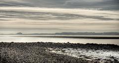 Layered Landscape at Lindisfarne (neilalderney123) Tags: ©2017neilhoward landscape lindisfarne holyisland cloud bamburg castle olympus omdwater northumbria northumberland