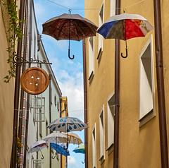 """Button Sign and Umbrellas on Passau's Höllgasse Art Alley (ggppix) Tags: button sign schild umbrellas schirme höllgasse artalley kunstgasse """"diealtstadt"""" art crafts craftspeople tailor passau bavaria bayern germany deutschland"""