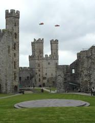 Welsh flags flying (bryanilona) Tags: flags dragons caernarfon castle wales courtyard turrwets flagpoles
