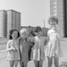 There's always one!  Four little girls in the shadow of the Ballymun tower blocks.