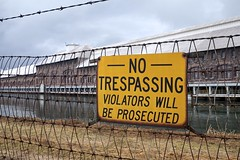 no trespassing (twurdemann) Tags: barbedwire detailextractor edisonsault fujixt1 headrace hydroelectricplant intake michigan nikcolorefex notrespassing portageavenue powercanal powerplant procontrast rain romanesque sandstone saultstemarie sign spring stmarysriver unitedstates water weather xf1855mm