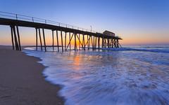 Here Comes The Sun (Yogi.Arora) Tags: seascape beach sunrise landscape coast pier newjersey day nj clear belmar jerseyshore atlanticocean canon1740l canon5dmk2 fishingpeir belmarfishingpier