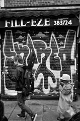 DSC_0928RED (Di's Free Range Fotos) Tags: blackandwhite graffiti shutters skared filleze