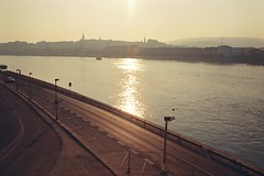 2.8 Days later (habeebee) Tags: road city sunlight reflection water skyline fence river still hungary quiet empty budapest shades hazy duna danube buda lateafternoon lampposts magyarország