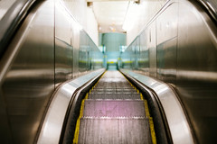 Escalator (JoelZimmer) Tags: newyork unitedstates bokeh manhattan lowereastside escalator highlighted 35mmf14 fujixe1
