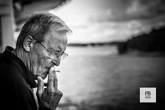 Let's go away (Felice Bassani) Tags: old sea bw man leave canon finland glasses mare ship sad turku bn smoking ponte triste deck nave 5d finlandia vecchio occhiali fumare partire