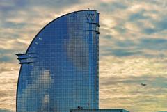 Hotel W - Barcelona (bervaz) Tags: barcelona sunset espaa hotel cloudy 135 avin catalua 135mm ricardobofill hotelw hotelvela carlzeisssonnart sal135f18z 135mmf18za vision:mountain=051 vision:clouds=0634 vision:outdoor=0894 vision:sky=0898 carlzeisssonnart135mmf18telephotolens sonyalphadigitalslr