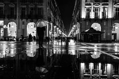 Riflessi di pioggia - Rain reflections. (sinetempore) Tags: torino turin street biancoenero blackandwhite uomo man ombrello umbrella riflesso reflection piazzacastello luci light pioggia rain riflessidipioggia rainreflections