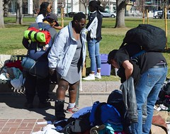The Colorado State Capitol building is the backdrop for a free clothing giveaway in downtown Denver sponsored by two area churches. (desrowVISUALS.com) Tags: poverty poorpeople austerity hardtimes charity needy service freeclothing clothinggivaway theinspirechurch therefugechurch rconomics