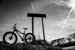 Destination_Unknown (PJT.) Tags: unknown lydiate merseyside lancashire junction cheshire lines bike snow fat 9zero7 silhouette road tarmac grass edge jet jetstream contrail contrast sun sky upright post pole wire telegraph cycle commute