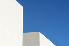 Two white buildings (Jan van der Wolf) Tags: map 167165v minimalism minimalistic building gebouwen blue blauw white abstract sky arinaga architecture architectuur lines lijnen composition compositie grancanaria simple simpel