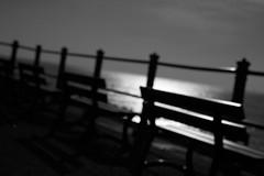 by the sea II (ChrisRSouthland) Tags: sea promenade hastings england monochrome blackwhite blackandwhite nikond800 benaches backlit glare nikkor85mmf18