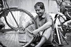 | THE SMILE :) | (iam_aanwar) Tags: smile street bw raod dhaka worker