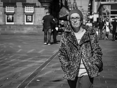 Coming Undone (Leanne Boulton) Tags: monochrome people portrait urban street candid portraiture streetphotography candidstreetphotography candidportrait streetportrait eyecontact candideyecontact streetlife woman female face facial expression eyes look emotion feeling unhappy fur coat spring weather style individual tone texture detail depthoffield bokeh naturallight outdoor light shade shadow city scene human life living humanity society culture canon canon5d 5dmkiii 70mm character ef2470mmf28liiusm black white blackwhite bw mono blackandwhite glasgow scotland uk
