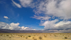 View from the Junction of Hwy. 190 and the Panamint Valley Road, Death Valley, looking north (Ms. Jen) Tags: california deathvalley inyocounty lumia lumia950 march2017 march25th panamintsprings panamintvalley panamintvalleyroad photobyjeniferhanen clouds desert msjencom roadtrip wildflowers