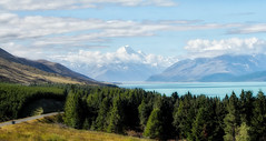 Land of the Gods (geemuses) Tags: lakepukaki mountcook newzealnd mountains mountainous southernalps northisland newzealand water lake blue color colour trees green sky landscape scenic scenery nature beauty snow ice clouds