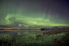 Eye of Aurora (John Andersen (JPAndersen images)) Tags: abandoned alberta aurora beiseker borderfx house night pond radiobeacon reflections stars visipix
