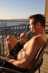 Inhale... - With Vaporizer Smoking Over the Bay (Blue Rave) Tags: 2017 ca california sandiego meninshorts guysinshorts legs thighs sitting barechest shirtless shorts bloke dude guy male mate people smoker smoking half halfface halffaceportraits side sideportrait bay water sandiegobay patio