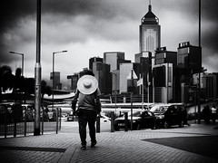 Kowloon Cowboy (Feldore) Tags: central district hong kong cowboy hongkong straw hat gardener skyscrapers skyline street candid gritty feldore mchugh em1 olympus 1240mm man walking