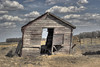 Prevailing winds from the north? (Laurie4593) Tags: farm farmyard weathered wood shed old prairies 50mm canonrebelt3i sunny barnboard