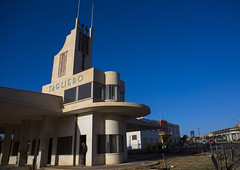 Fiat Tagliero Garage And Service Station, Asmara, Eritrea (Eric Lafforgue) Tags: africa travel color colour building horizontal architecture outdoors photography italian fiat nobody nopeople artdeco copyspace decline futuristic clearsky asmara eritrea hornofafrica eastafrica capitalcities eritreo buildingexterior colorpicture erytrea lowangleview asmera eritreia colourimage italiancolony إريتريا ertra 厄利垂亞 厄利垂亚 エリトリア eritre eritreja eritréia tagliero colourpicture эритрея érythrée africaorientaleitaliana ερυθραία giuseppepettazzi 厄立特里亞 厄立特里亚 에리트레아 eritreë eritrėja еритреја eritreya еритрея erythraía erytreja эрытрэя اريتره אריתריה เอริเทรีย colonialitalianarchitecture italiancolonialempire maekelregion eri3553