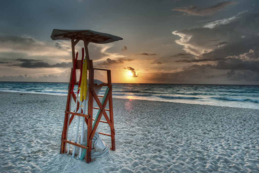 A lifeguard stand on the Cancun Beach at sunrise.