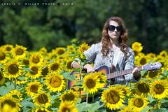 255. sunflower serena (dogfaceboy) Tags: girl guitar daughter sunflowers serena