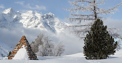Pyramid in the snow (Michel Couprie) Tags: red mountain snow france alps tree monument clouds montagne alpes canon eos pyramid pass 7d neige michel nuages pyramide col hautesalpes lautaret couprie ef35f14l