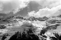 04a3371 19 (ndpa / s. lundeen, archivist) Tags: nick dewolf nickdewolf bw blackwhite photographbynickdewolf film monochrome blackandwhite april 1971 1970s 35mm europe centraleurope switzerland swiss alpine alps graubünden grisons stmoritz easternswitzerland suisse schweitz mountains peaks snow snowy snowcovered skiresort skiarea skislopes landscape sky clouds swissalps