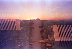 Horizon Fuji (Hayden_Williams) Tags: tokyo tokyometropolitangovernmentbuilding japan travel asia explore view overlook city cityscape buildings sky skyline skyscrapers horizon abstract surreal sunset fuji mtfuji film fd50mmf18 analog analogue canonae1 kodakportra400 tripleexposure multipleexposure