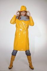 Ursula Andress in vinyl coat (PVC Fashion) Tags: ursula andress shiny sexy yellow pvc vinyl plastic coat raincoat mac 1960s fashion clothing beauty celebrity celebrities actress women lack lackmantel