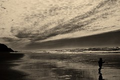 Beach Runner (niKonJunKy22) Tags: beach runner running kid kids cold water oregon coast oregoncoast monochrome mono d700 nikon 50mm nikkor prime shine reflection sky clouds sunset child ocean pacific shore shoreline tide nature usa ngc silhouette shadow