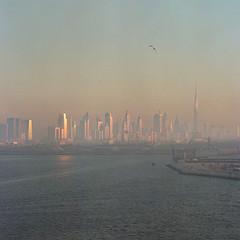 Dubai - Kodak Porta 800 exp* (magnus.joensson) Tags: arabia dubai sunset ocean hasselblad 500cm zeiss sonnar 150mm kodak porta 800 exp2006 handheld grain c41