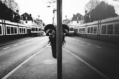hello there (matthias hämmerly) Tags: zürich zuerich switzerland street streetphotography woman sun shadow contrast grain ricoh gr black white bw monochrom monochrome city town urban mirror reflection symmetrie