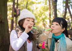 Happy sisters blowing bubbles together in forest (Apricot Cafe) Tags: img29190 3039years asia asianandindianethnicities japan japaneseethnicity kyotojapan sigma35mmf14dghsmart blowing candid casualclothing charming cheerful day enjoyment forest freedom friendship happiness horizontal lifestyles morning nature onlywomen outdoors photography relaxation sister smiling soapsud springtime togetherness tourism tourist traveldestinations twopeople waistup weekendactivities women yoshidayama youngadult kyōtoshi kyōtofu jp